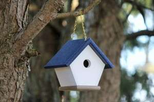 Navy Blue recycled plastic wren house hanging in a tree